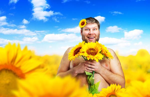 portrait, of, man, in, sunflower, field - 28076439