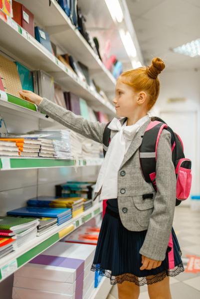 school girl at the shelf in