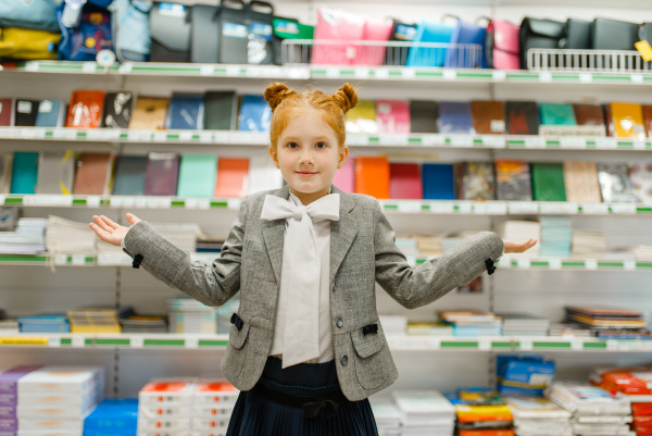 girl at the shelf in stationery