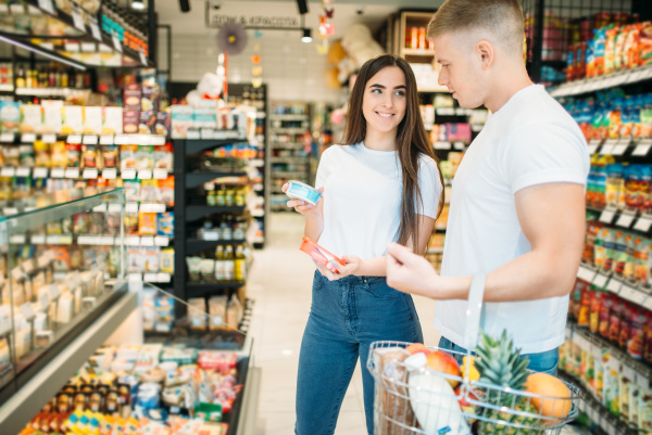 young, couple, choosing, products, in, supermarket - 28077451