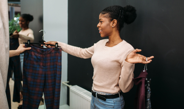 girlfriends choosing clothes in the dressing