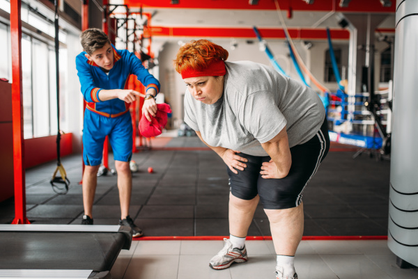 instructor forces fat woman to exercise