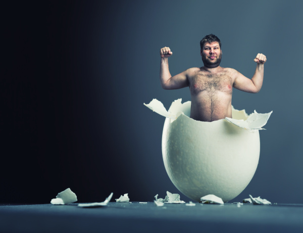 egg with man inside isolated on