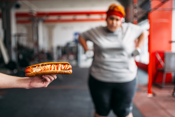 trainer with hotdog forces fat woman