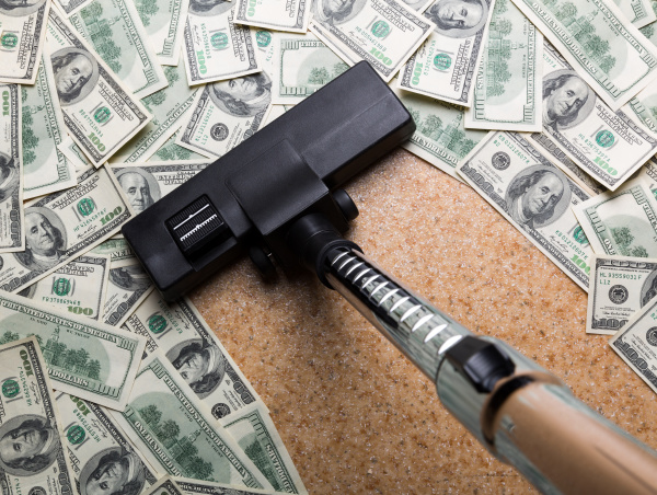 money on the floor vacuuming with