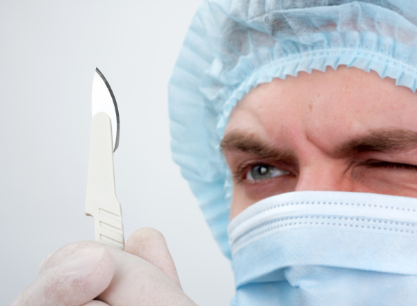 serious surgeon with knife