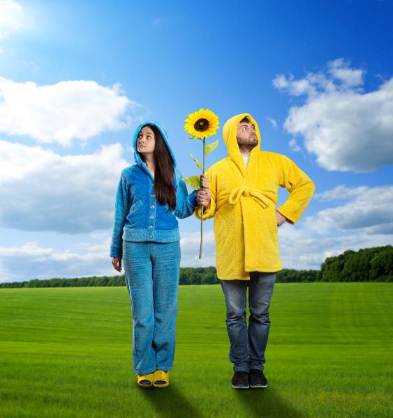strange couple holding sunflower