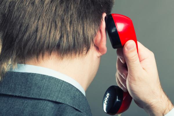 portrait of a man speaking phone