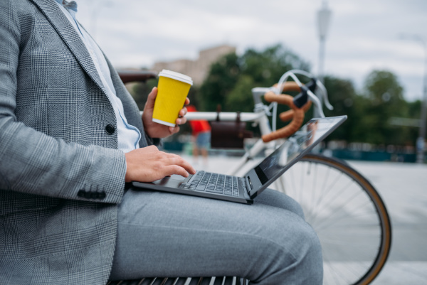 businessman with cycle drinks coffee on