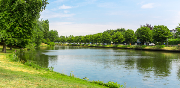 park with lake in old european
