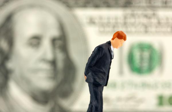 figurine of loser businessman