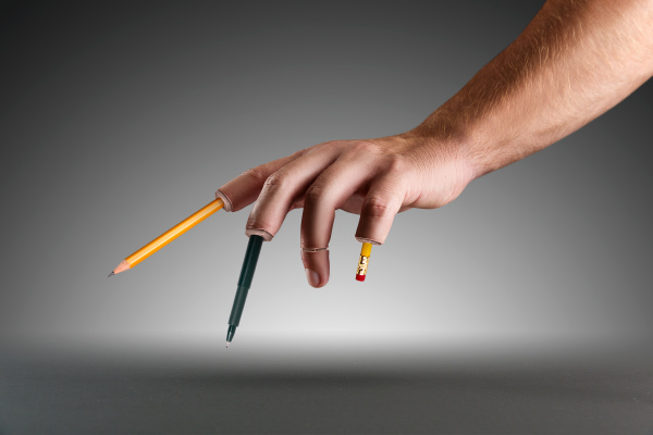 hand with pen and pencils instead
