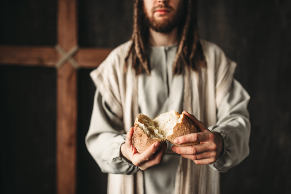 jesus christ gives bread to faithful