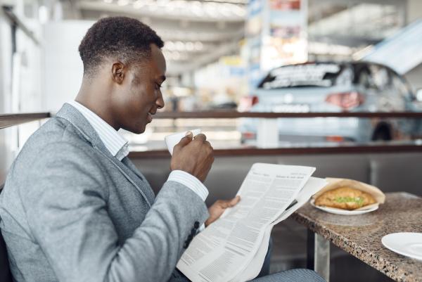 ebony businessman having lunch in office