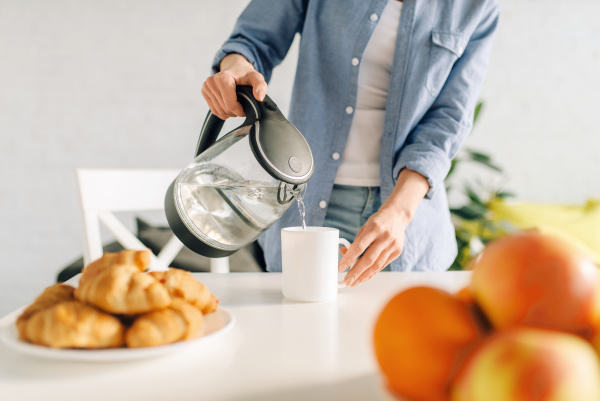 happy woman cooking breakfast on the