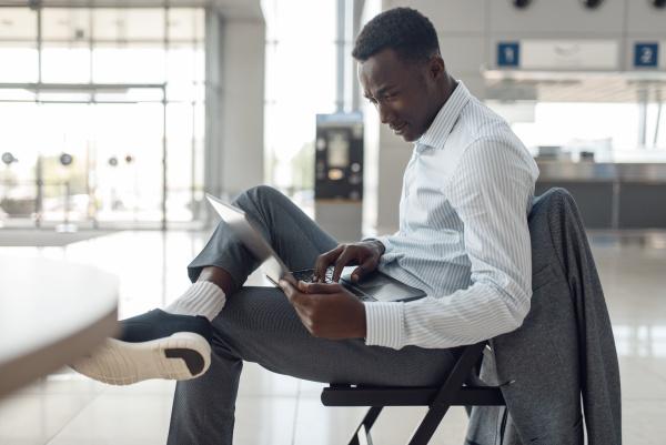 black businessman using laptop in car