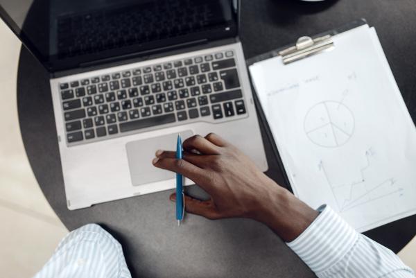 black businessman working on laptop top