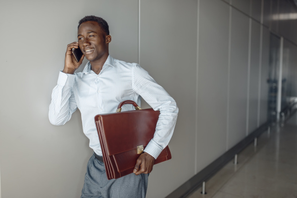 businessman talking by phone in office
