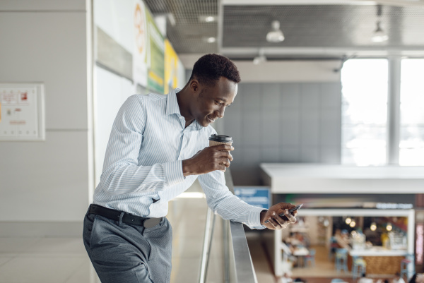 black businessman with cup of coffee