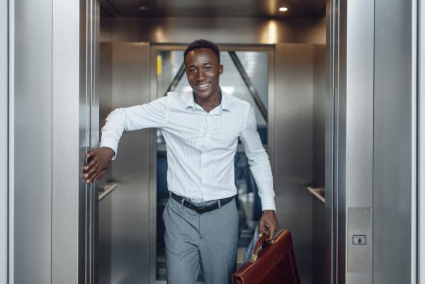 black businessman goes into the elevator