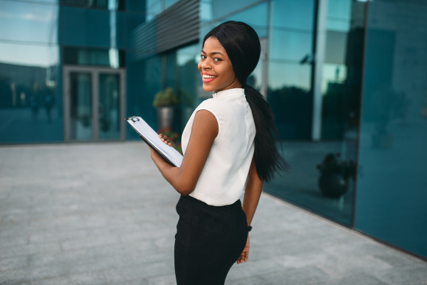 business woman with notepad outdoors