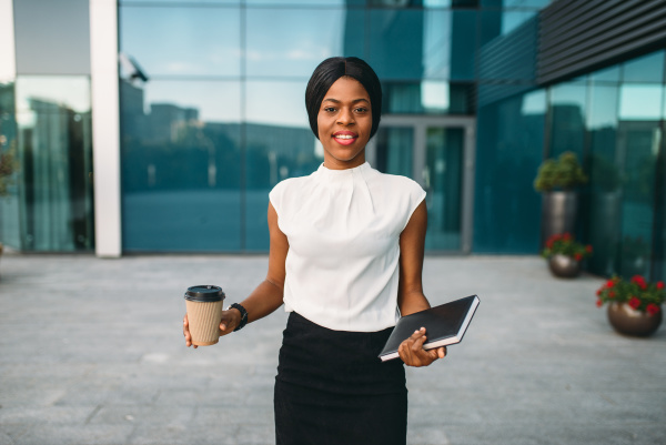 business woman with coffee against office