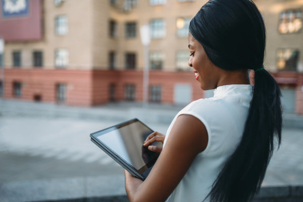 business woman looks on laptop in