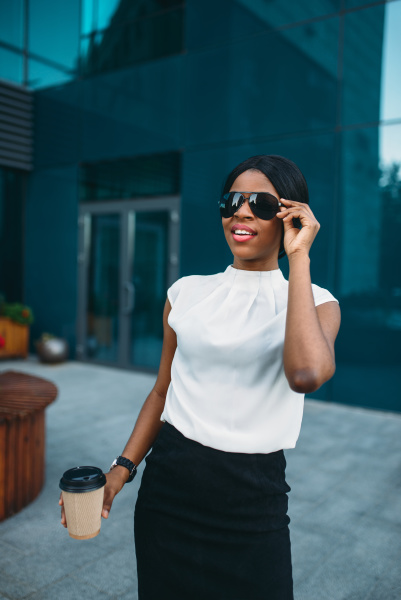 business woman in sunglasses with coffee