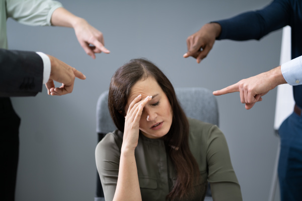 many hands pointing the stress businesswoman