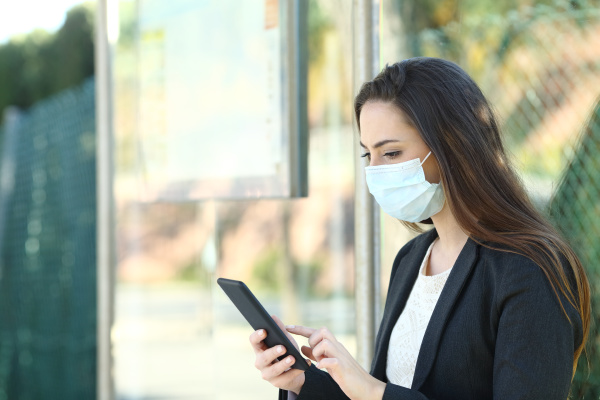 woman wearing a protective mask using