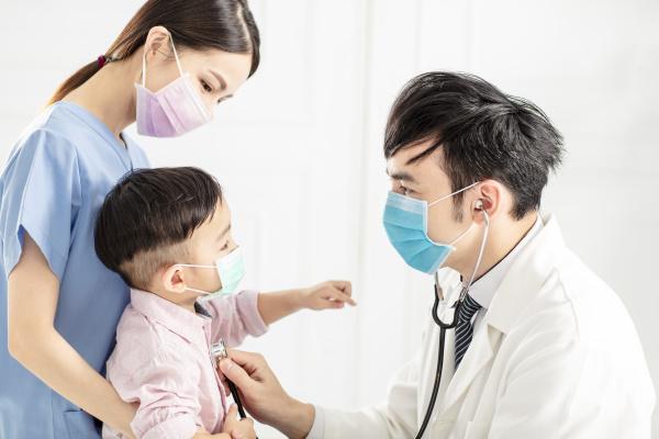 medical doctor examining little boy