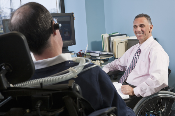 businessmen in wheelchairs working in an