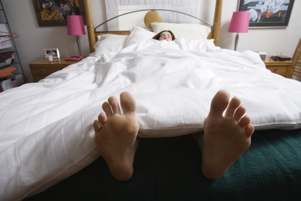 young woman sleeping in a bedroom