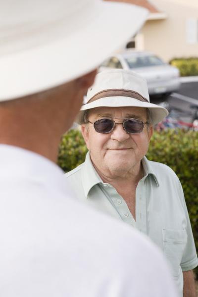 senior man talking with another senior
