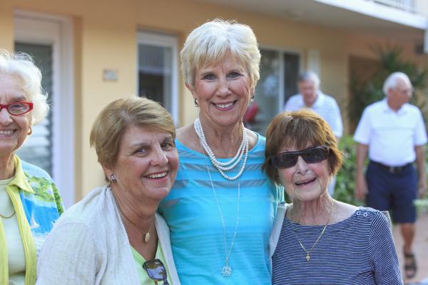 three senior women pose for a