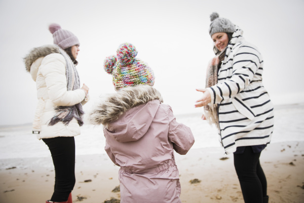 family in warm clothing on winter