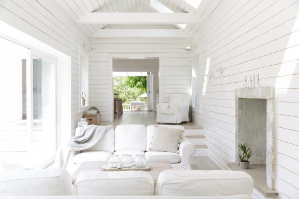 white wood shiplap home showcase beach
