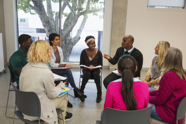 people talking in support group meeting