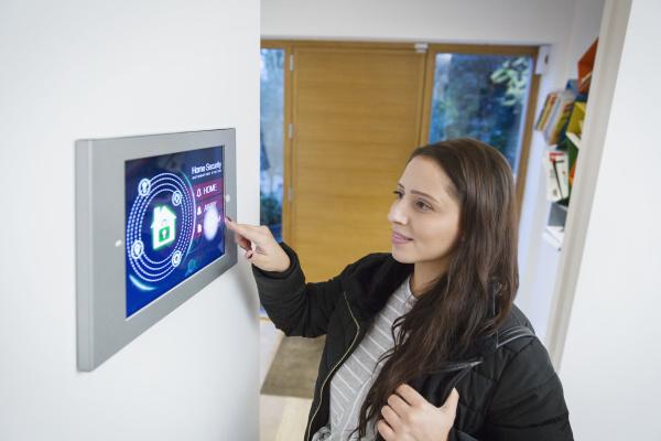 woman leaving house setting smart home