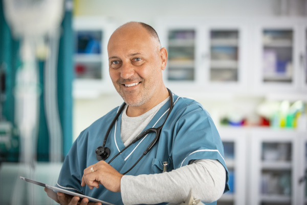 portrait confident male doctor with digital