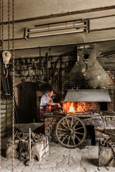 blacksmith standing on fire in furnace