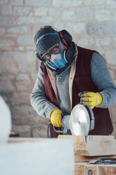 stonemason with protective clothing working