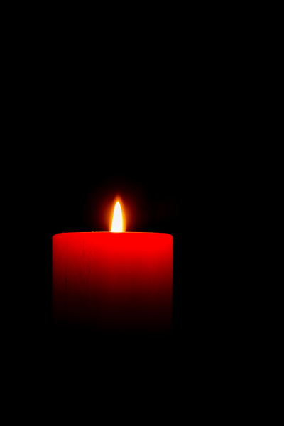 a red candle in the dark