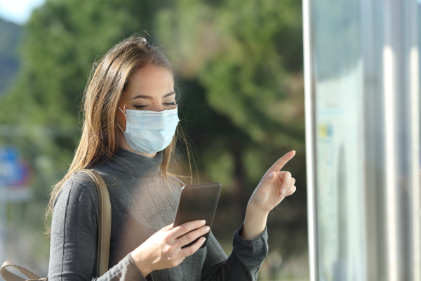 commuter with a protective mask checking