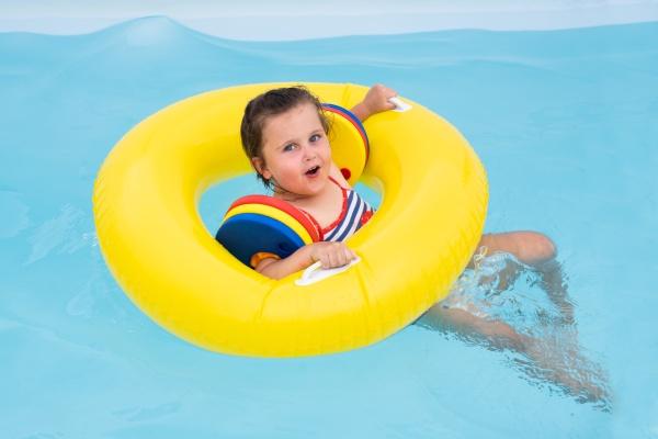 little girl having fun in pool
