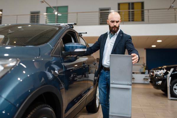 man studies the configuration car