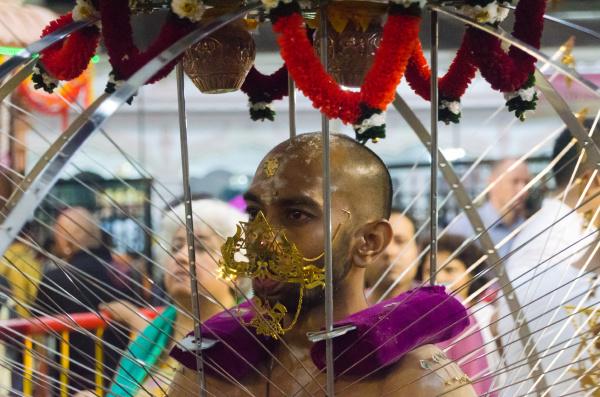 male devotee carrying kavadi in singapore
