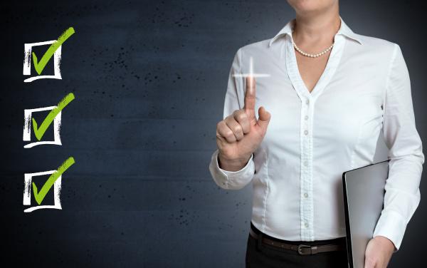 checklist touchscreen is shown by businesswoman