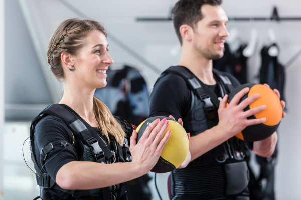 fit woman and man with ball