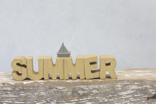 word summer on wooden plank